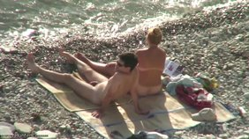 Amateur couple decides to get a little cozy on a beach