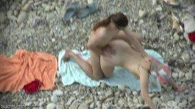 rCrazy cock-riding and doggy style sex on a beach