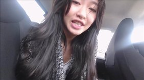Asian girlfriend fucks her pussy with a clit-rubbing toy in the backseat