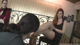 Redheaded babe humiliates her slave in front of her GF
