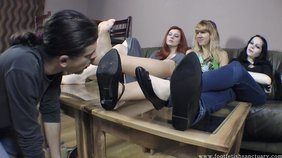 Three sexy girlfriends have a foot-cleaning slave boy
