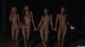 Four completely naked and gorgeous nymphs are dancing outdoors