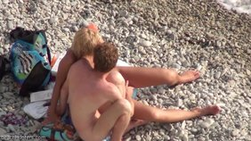 Slutty babe making out with her nudist boyfriend on a beach