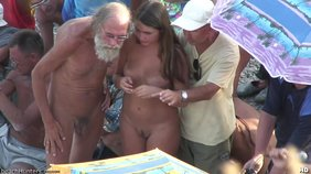 Creepy old man lurking around young nudist babes