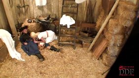 Blond-haired bombshell dressed in white riding a cowboy's cock in a barn