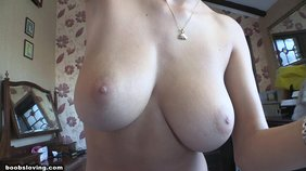 Short-haired redhead showing her immaculate natural tits in POV