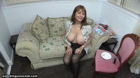 Black stockings brown-haired beauty squeezing her tits and showing off
