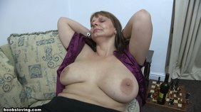 Fat older lady opens up her purple blouse and shows off her fat tits
