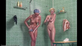 Nasty young babes showering together on camera
