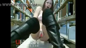 Boots-wearing brunette showing her delicious pussy up close on camera