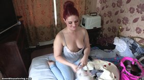 Redheaded amateur GF packing stuff and showing off her hot breasts here